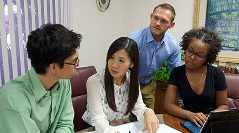 students and faculty work together