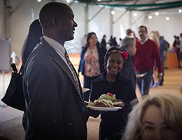 Man with food plate in hand smiling